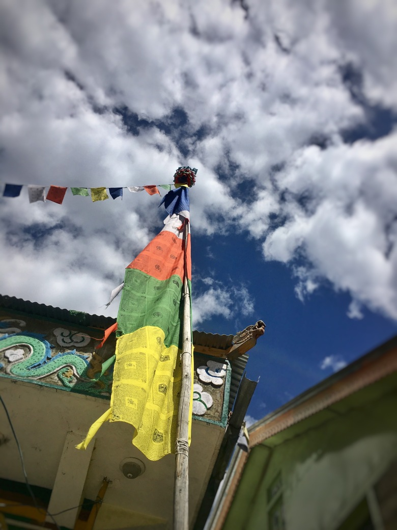 flags on a temple in sangla valley, India